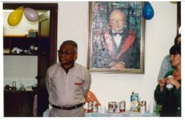 Laki in front of Wally portrait (1) - Copy - Copy - Copy